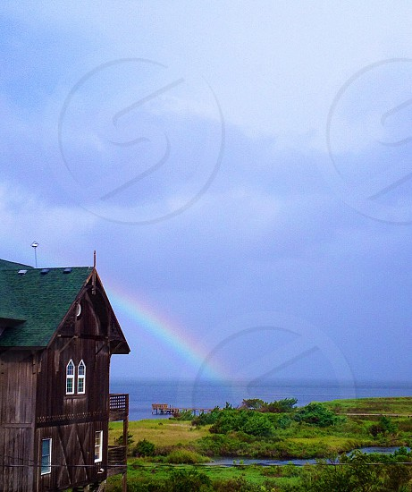 rainbow at the end of the ocean photo