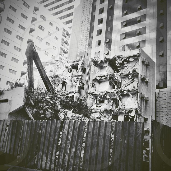 Demolished building centered and surrounded by other buildings photo