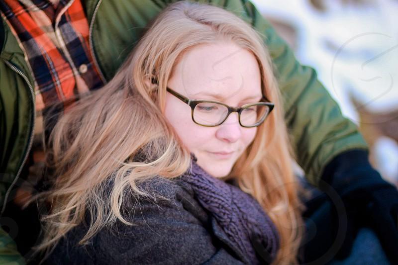 woman in gray coat sitting beside man photo