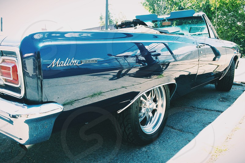 Reflections in a Classic Chevy Malibu.  photo