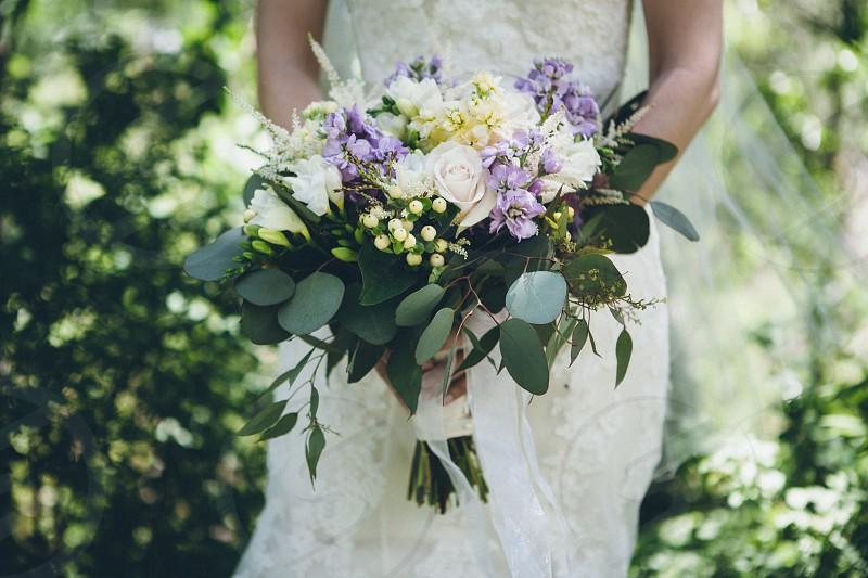 bride holding her wedding bouquet photo