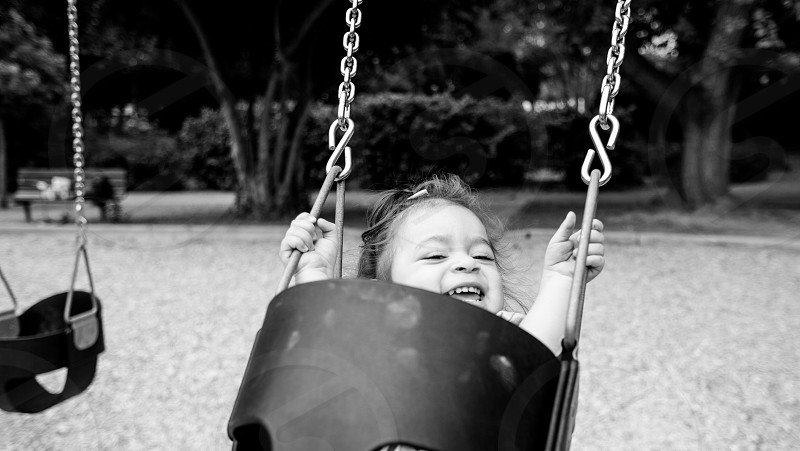 baby swinging photo