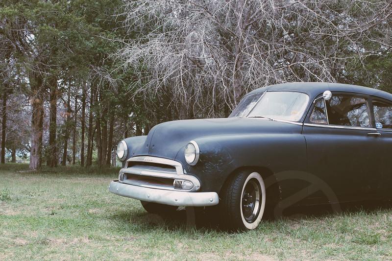blue vintage American sedan photo