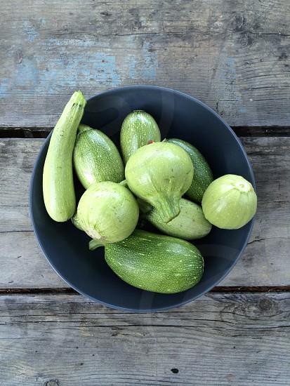 zucchini green bowl wood table farm organic photo