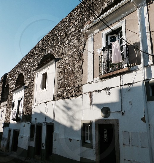 Old houses on a street in Evora Portugal. Laundry day.  photo