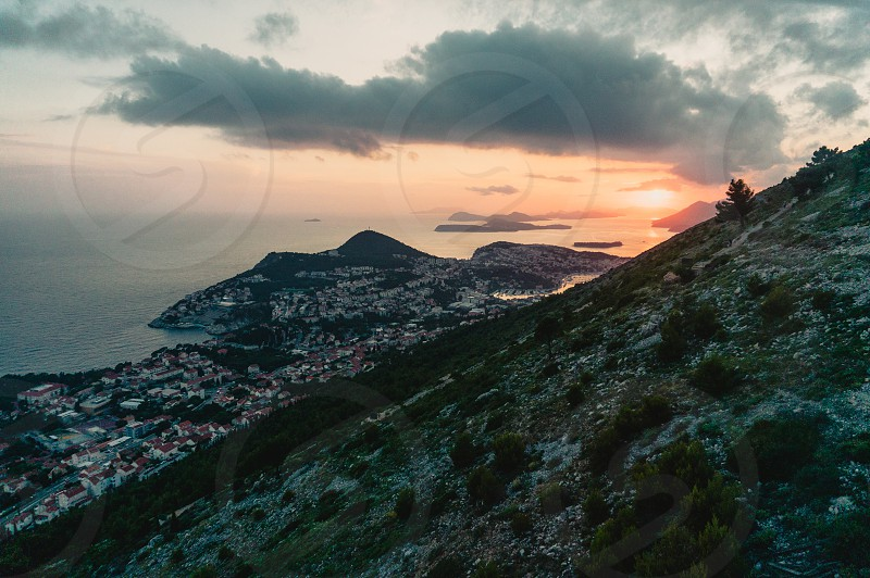 Looking down below at Dubrovnik Croatia during the sunset photo