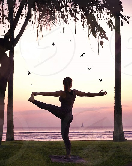 Hawaii sunset Yoga pose in a park  photo