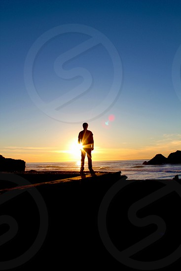 man in sunset photo