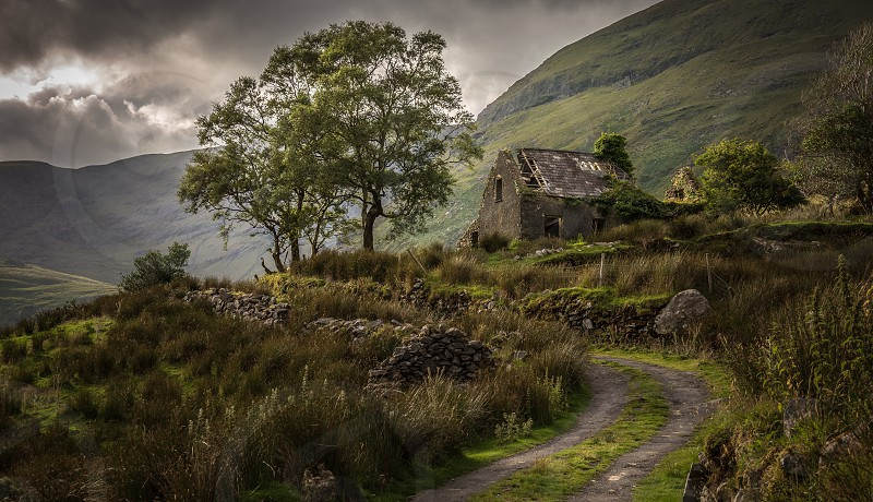Wild cottage house old abandoned trees mountains remote road path ireland Killarney black valley photo