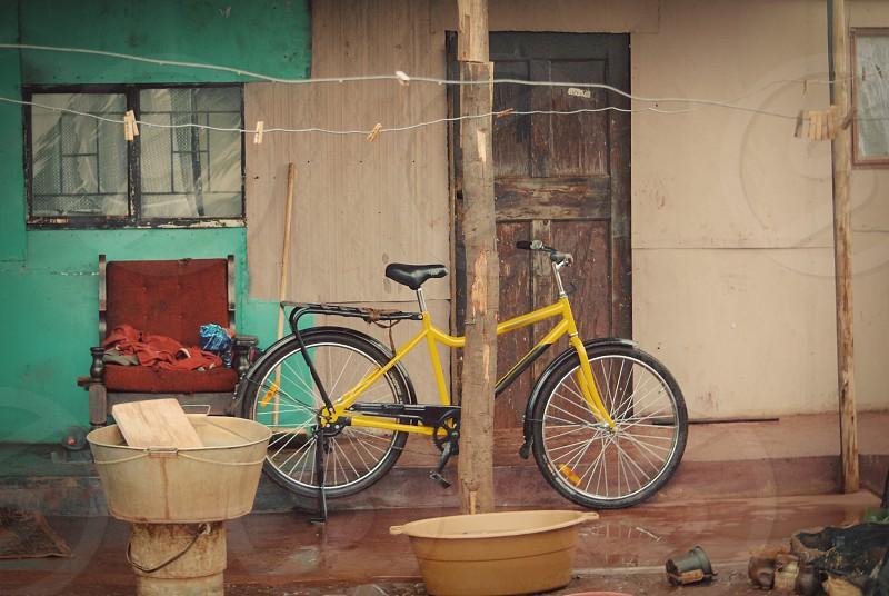 Bicycle South Africa rain informal settlement township yellow bike cycle. photo