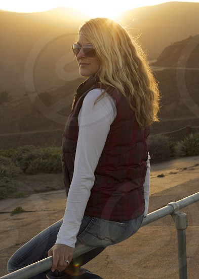 womens red brown puffy vest photo