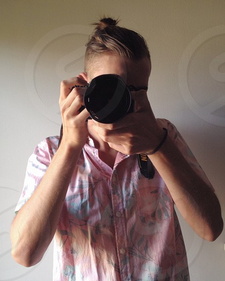 man taking a picture photo