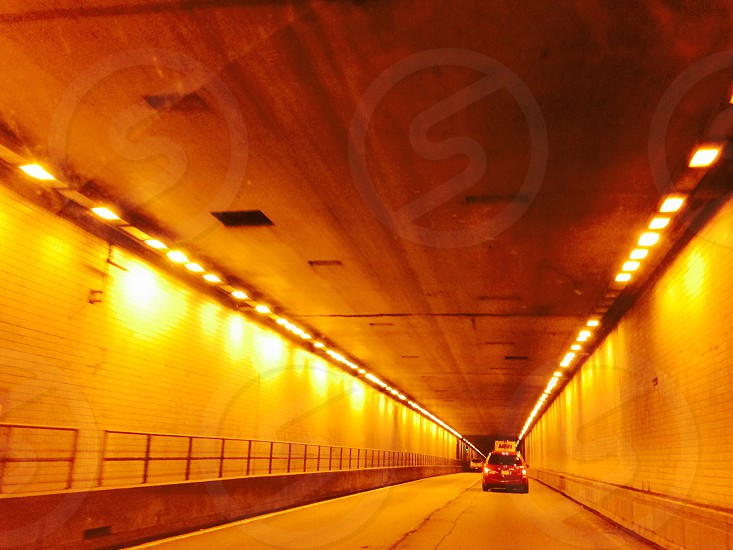 red hatchback in tunnel photo