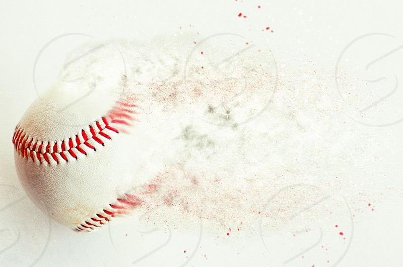 Abstract baseball image with ball and dust.  Graphic art for print or use as background for sports team or league. photo