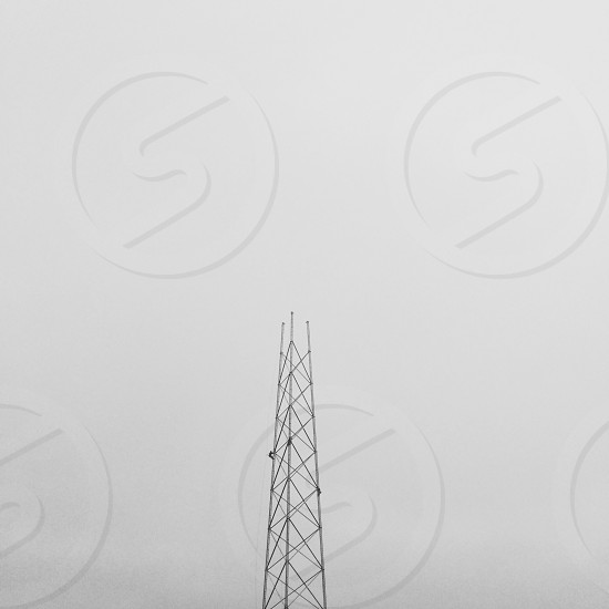 Antenna tower cell phone tower connected fog negative space triangles photo