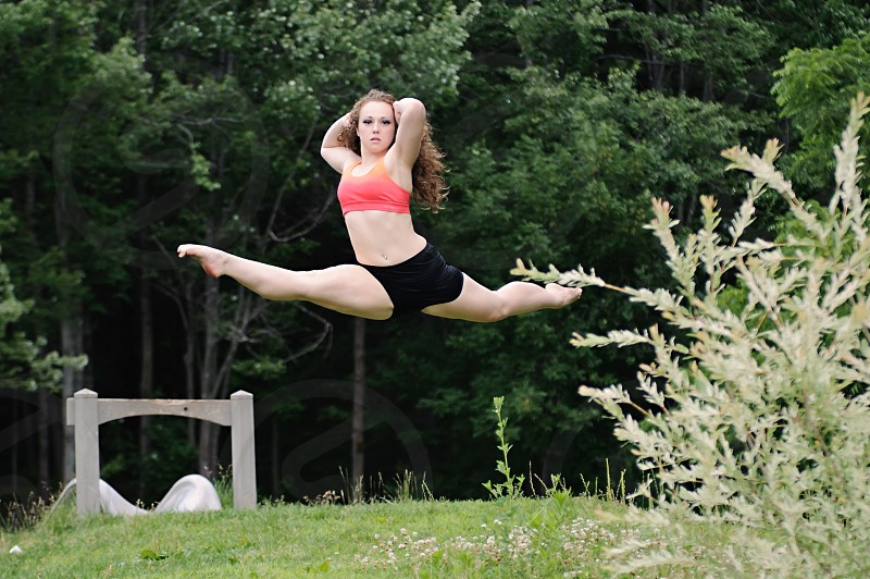Dancer in a jump outdoors photo