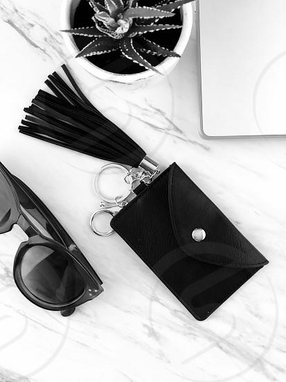 Elegant black challenge sunglasses wallet laptop desk photo