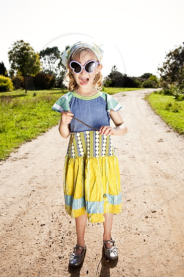 vibrant colorful daytime sunshine bright dynamic energetic eccentric child girl kid young vivacious bold yelling laughing screaming joyful funny happy lively outdoors nature  photo