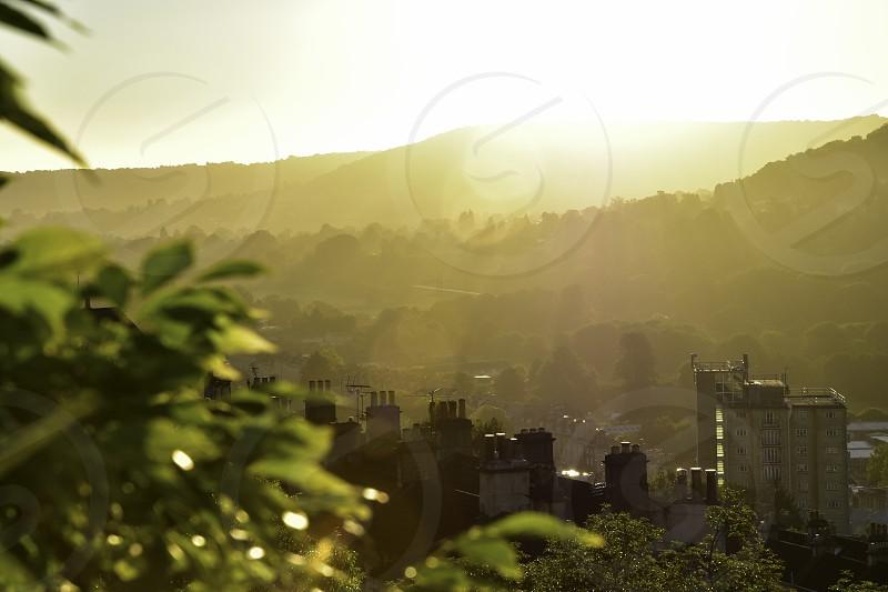 Sunrays and misty landscape  photo