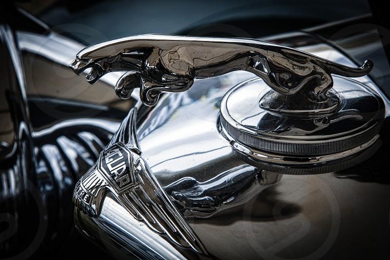 Close-up of an old Jaguar automobile emblem photo