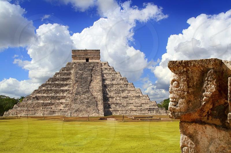 Chichen Itza Tzompantli the Wall of Skulls and Kukulkan pyramid photo