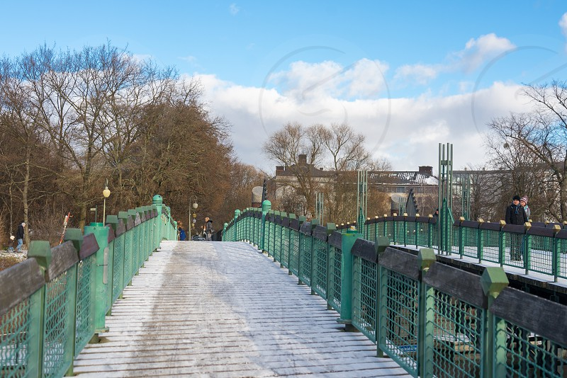 Activities around Lichtensteinbrücke bridge which cross Landwehr Canal and Luxembourg Gedenkstätte in winter season inside Tiergarten Neighborhood in Berlin Germany photo