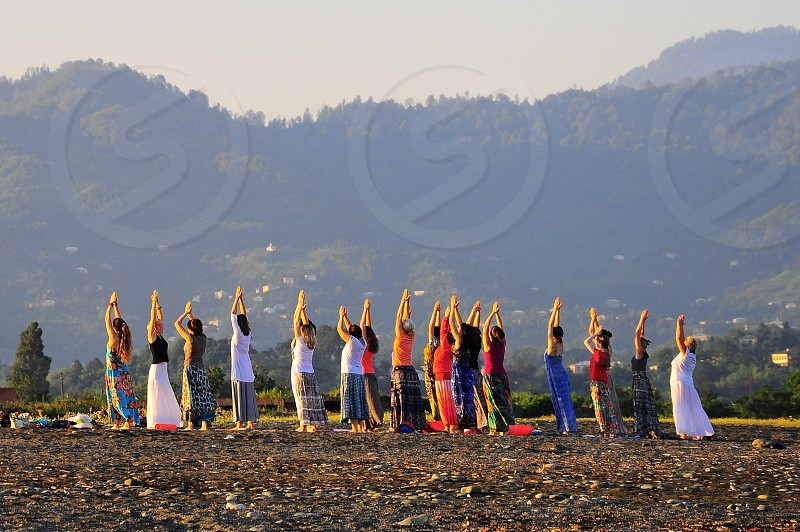 women doing yoga photo
