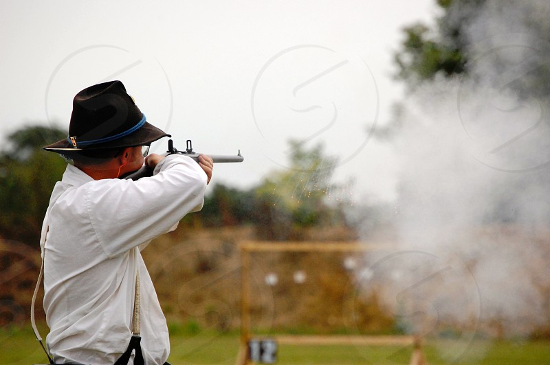 Man shoots carbine and sparks fly photo