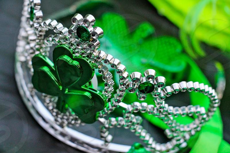 close up photo of green clover silver tiara photo