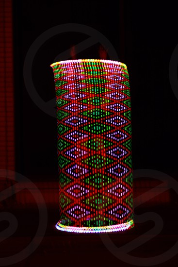 green pink and red knitted textile photo