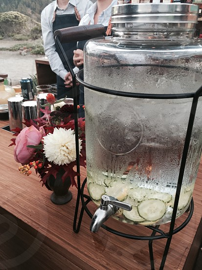 Beautiful wedding bar with cucumber water and flowers. photo