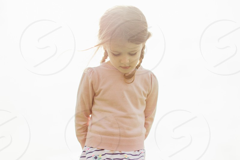 Young girl wearing her sweater backwards  photo
