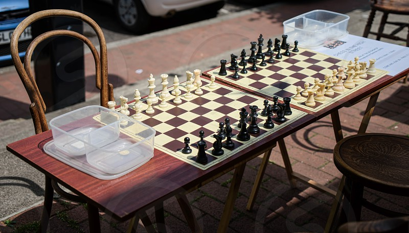 EAST GRINSTEAD WEST SUSSEX/UK - JUNE 17 : Chess Boards in the Street Ready for a Game in East Grinstead on June 17 2017 photo