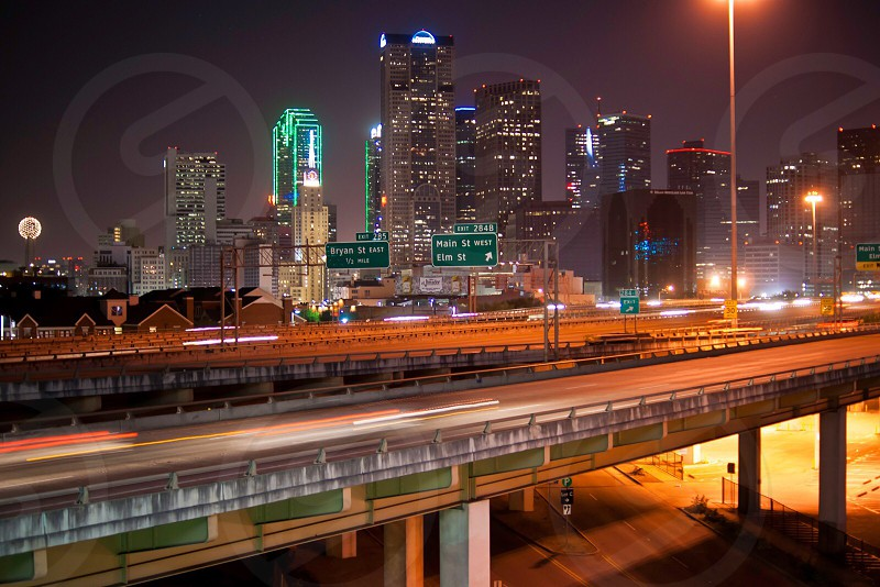 cement bridge with city view background at night photo