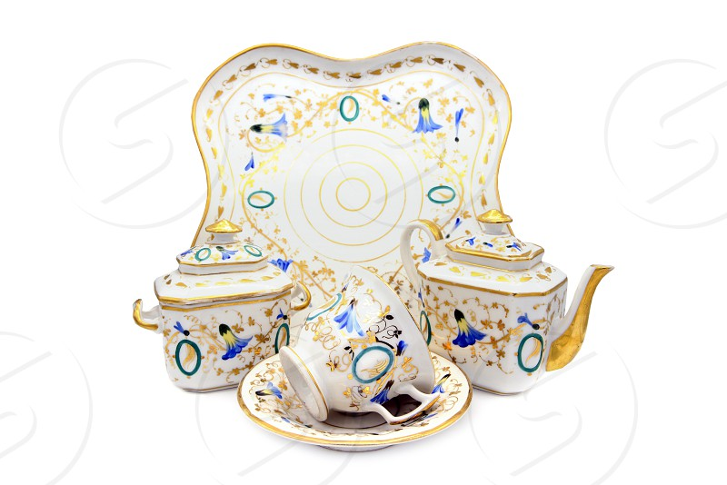 Antique Biedermeider coffee and tea time set with plat cup and pot. white isolated background photo