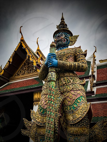 Outdoor day colour vertical portrait Grand Palace Bangkok Thailand Kingdom travel tourism tourist wanderlust gold gold leaf Buddhist Buddhism holy royal regal monarchy temple temples mosaic mirror tile tiles ornate shrine royal regal royalty attraction guard imperial photo