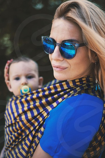 baby young youth mom mother woven wrap stripes blue sunglasses smile beauty summer day portrait hug photo