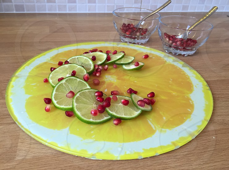 Pomegranates and limes - keep healthy over the summer season with fresh fruits photo