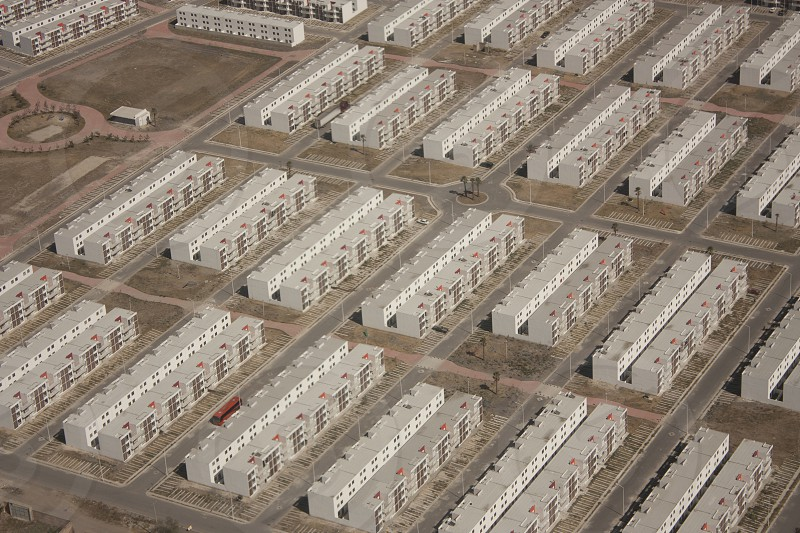Aerial view of housing complexes of white houses that form the urban landscape of Mexico City observed from the window photo