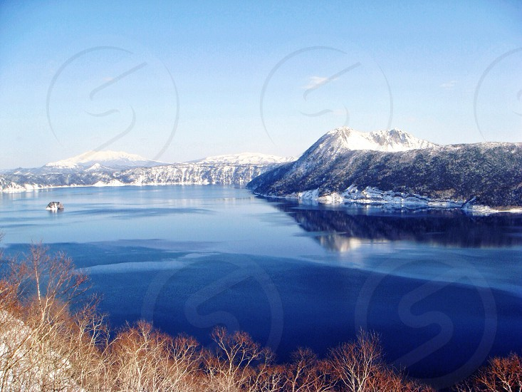 snow top mountain and blue lake  photo