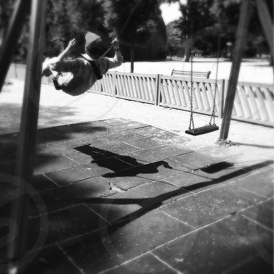 swinging on swing set photo
