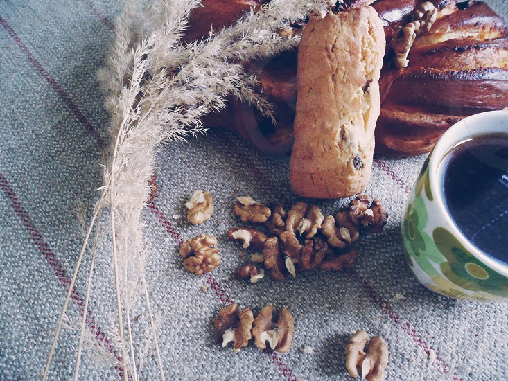 brown cereals beside mug of coffee with bread and brown dry leaf photo