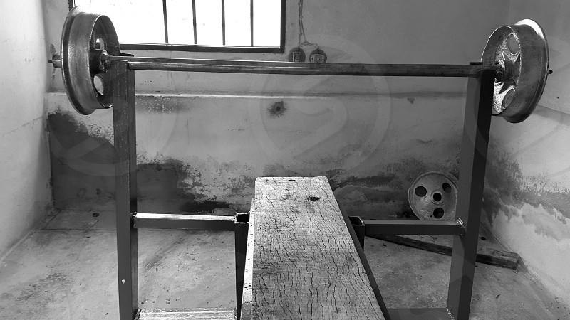 precarious gym done in a room abandoned  photo