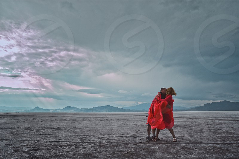two young adults kissing in Utah Salt flats photo