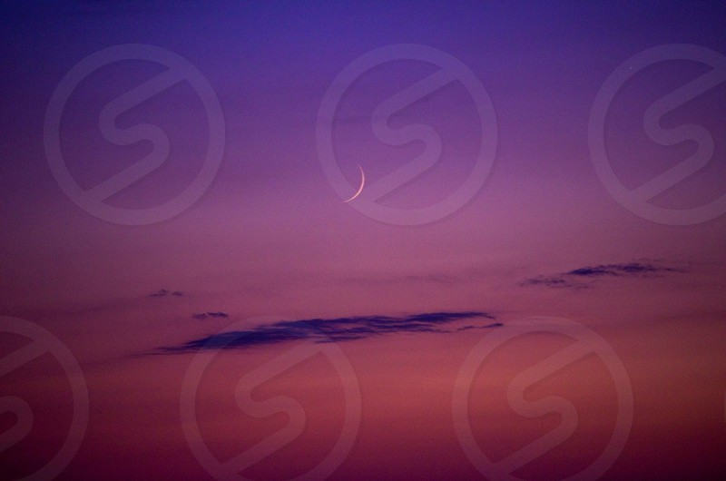crescent moon under blue sky photo