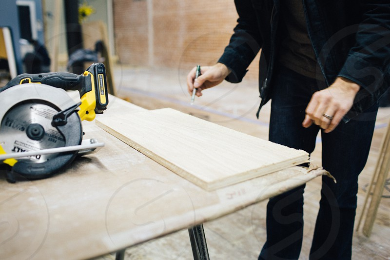 Man measuring a board to cut for a project. photo
