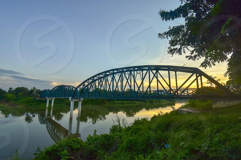 The steel bridge behind the sunset in Sukhothai Thailand photo