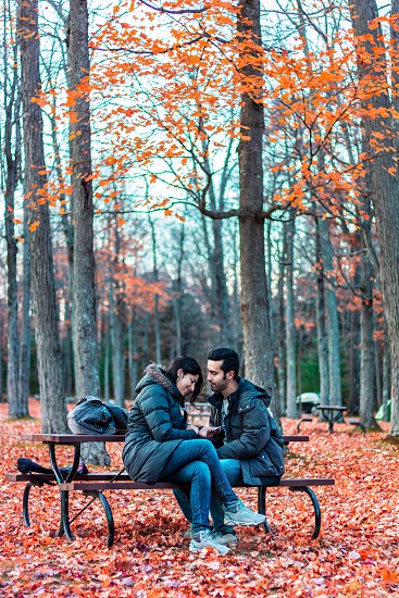 Love friendship friends couple young people youth nature park national park sitting fall fall colours  photo