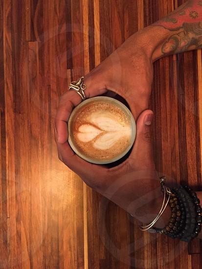 cappuccino coffee with heart foam design photo