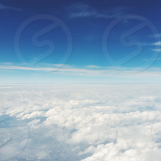 bed of white clouds under blue sky during daytime photo